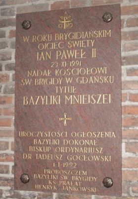 Plaque commemoratory title of basilica minor at Church of St. Bridget in Gdańsk