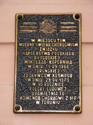 Plaque polish scouts on building in Toruń Old Town